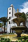SAN BARTOLOME LANZAROTE Village plaza square fountain and clock tower white buildings
