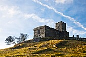Looking up at the Church of St Micheal de Rupe on Brentor, Dartmoor Devon England UK