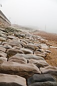 sea defence laid stones on beach worn down by the action of water