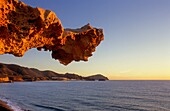 Gargoyle Rocks eroded by wind, sea water and sand in Playa del Arco Los Escullos  Cabo de Gata-Nijar Natural Park  Biosphere Reserve, Almeria province, Andalucia, Spain