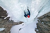 David Weber ice climbing a route which is rated WI4 near Silver Creek high in the Boulder Mountains in central Idaho