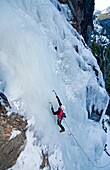 Man ice climbing a route called Tobacco Gully which is rated WI3 and located near Rock Creek in the Elkhorn Mountains in eastern Oregon