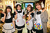 Cute young Japanese girls working at Popopure Maid Cafe wear French maid's uniforms and perpetual smiles in Akihabara located near the Kanda River in the Chiyoda-ku District, Tokyo, Japan