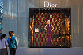 The afternoon sun illuminates the exterior of the Christian Dior boutique on Omotesando Avenue in the trendy yet upscale Harajuku District of Tokyo, Japan.