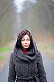 Woman enjoying a walk in the park in Winter