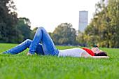 Beautiful woman lying down in park