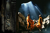 Monks under a collapsed roof of Ta Prohm Temple, Angkor, Siem Raep, Cambodia, Asia