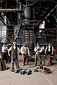Actors in ironworks at The Iron Gorge Museums, Blists Hill Victorian Town, Ironbridge Gorge, Shropshire, England, Great Britain, Europe