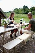 Couple having coffee and fresh cake, Klein Thurow, Roggendorf, Mecklenburg-Western Pomerania, Germany