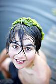 Boy with algaes on the head, lake Goldensee, Klein Thurow, Roggendorf, Mecklenburg-Western Pomerania, Germany
