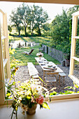 Well-laid table in a garden, Klein Thurow, Roggendorf, Mecklenburg-Western Pomerania, Germany