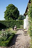 Man playing music in a garden, Klein Thurow, Roggendorf, Mecklenburg-Western Pomerania, Germany