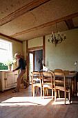 Man in a livinging room, Klein Thurow, Roggendorf, Mecklenburg-Western Pomerania, Germany