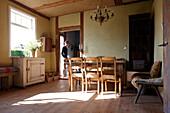 Man entering house, Klein Thurow, Roggendorf, Mecklenburg-Western Pomerania, Germany