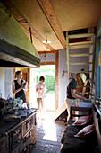 Family doing the dishes, Klein Thurow, Roggendorf, Mecklenburg-Western Pomerania, Germany