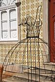 Dress rack in front of cork and robe museum, Sao Bras de Alportel, Algarve, Portugal, Europe