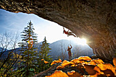 Two climbers at a rock face on a sunny day, Pinswang, Tyrol, Austria, Europe