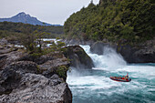 Jetboat excursion boat below Rio Petrohue Waterfall in Vicente Peres National Park, near Puerto Montt, Los Lagos, Patagonia, Chile, South America