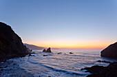 Steep coast at San Juan de Gaztelugatxe at sunset, Cape of Matxitxako, province of Guipuzcoa, Basque Country, Euskadi, Northern Spain, Spain, Europe