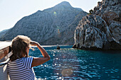 Woman looking towards the coast, sailing along the lycian coast, Ceneviz bay near Cirali, Lycia, Mediterranean Sea, Turkey, Asia