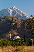 Mosque and Tahtali mountain near ancient Olympos, lycian coast, Lycia, Mediterranean Sea, Turkey, Asia