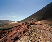 Hikers on ashfield in the Cha das Caldeiras underneath Pico Pequeno, Island of Fogo, Ilhas do Sotavento, Republic of Cape Verde, Africa