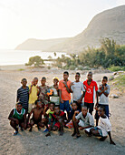 Group of football playing boys in the bay of Tarrafal, Santiago island, Ilhas do Sotavento, Republic of Cape Verde, Africa