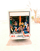 Delivery truck with surfers and african musicians driving to surf spot Ponta Preta, west of Santa Maria, Sal, Ilhas de Barlavento, Republic of Cape Verde, Africa