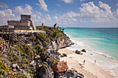 Ancient Mayan buildings at Tulum Ruins and people on the beach, Tulum, Riviera Maya, Quintana Roo, Mexico