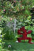 A Keith Haring sculpture with fountain in the background at Andre Hellers' Garden, Giardino Botanico, Gardone Riviera, Lake Garda, Lombardy, Italy, Europe