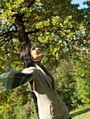 Woman enjoying an Autumn walk
