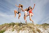 Teenage Girls jumping on Beach. Teenage Girls jumping on Beach