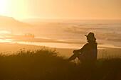 Woman watches Sunset on Beach. Woman watches Sunset on Beach