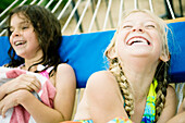 2 young girls laughing in hammock. 2 young girls laughing in hammock