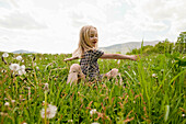 Child playing in field in springtime