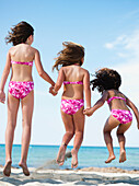 young girls playing on beach