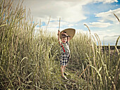 Boy playing with sword in wheat field. Boy playing with sword in wheat field