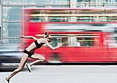 Athlete racing bus on city street. Athlete racing bus on city street