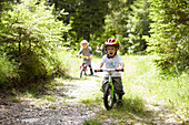 Toddler boy riding bike on dirt path. Toddler boy riding bike on dirt path