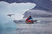 People kayaking near glaciers. People kayaking near glaciers