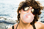 Woman blowing bubble on beach. Woman blowing bubble on beach