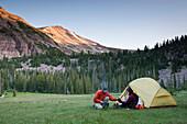 Hikers camping in rural landscape. Naturalist Basin, Moret Lakes