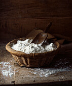 Organic flour in basket. Organic loose flour in hessianbasket with scoop