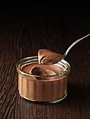 Pot au chocolat in glass ramekin. Pot Au Chocolate in Glass Ramekin with a portion on a teaspoon