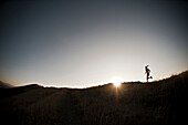 Woman running on dirt path. Bonneville Shoreline taril, Wasatch Foothills near Salt Lake City, Utah
