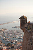 Woman admiring view from castle. View from Santa Barbara Castle, Alicante, Spain