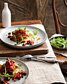 Plates of chicken with chorizo and salad. ChickenWithChorizo
