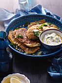 Plate of lamb flatbreads and yogurt. AnatolianLambFlatbreads