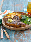 Plate of steak with potatoes and salad