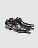 Close up of mans dress shoes. Still Life,Shoes,Black,Red,Smart, Business,shinny,shine,fashion,Graphic,Shadows,Photograph